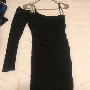 Black one shoulder dress.